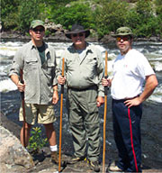 Three guys hiking at the French River in Canada